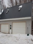 1 space in 4 car garage included in rent.